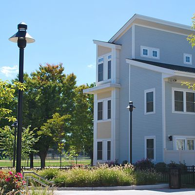 Beauty shot of completed residential development, showing stylish street light and flowers in landscaping