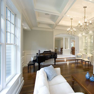 Groom Construction, custom residence living room windows, wainscoting and coffered ceiling