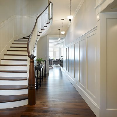 Groom Construction, custom residence staircase with decorative new post and wainscoting