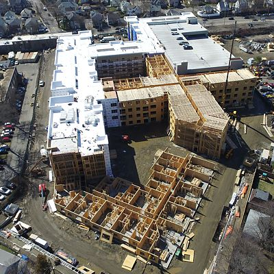 Aerial view overhead showing sections of framing in various stages of construction