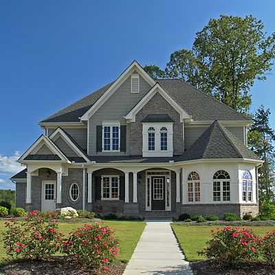 Beautiful custom home exterior with varied doors and windows