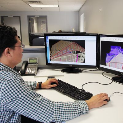 EWP designer working on building plans using MiTek Sapphire software