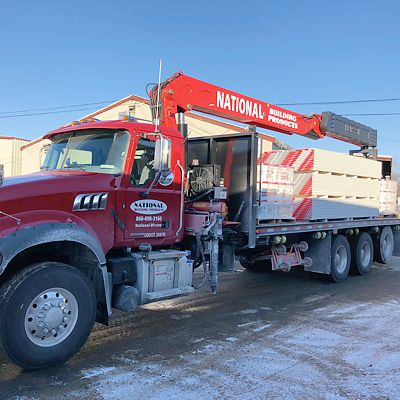 National Building Products boom truck with load ready for delivery in East Hartford