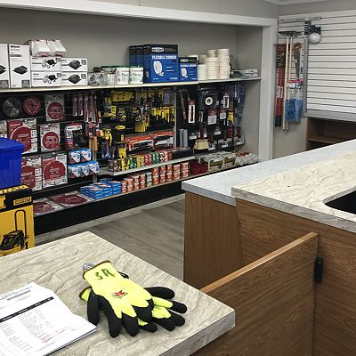Contractor supplies including Diablo saw blades, Stanley tape measures, and drywall installation supplies