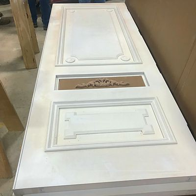 National Millwork custom door with ornamental details