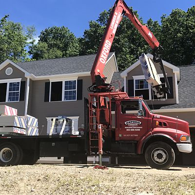 Oxford Lumber boom truck delivery to second floor of home