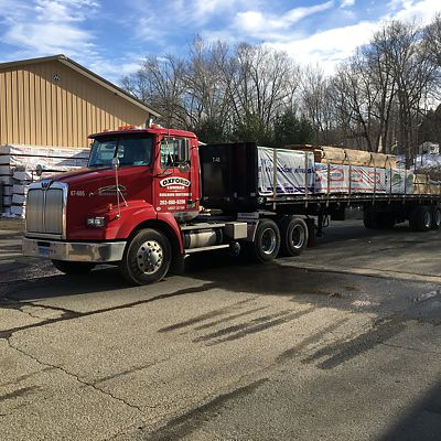 Oxford Lumber loaded flat bed truck