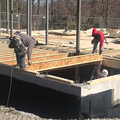 Precision end trim I-joists being installed