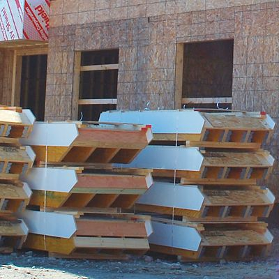 Prefabricated stair stringers stacked on the jobsite