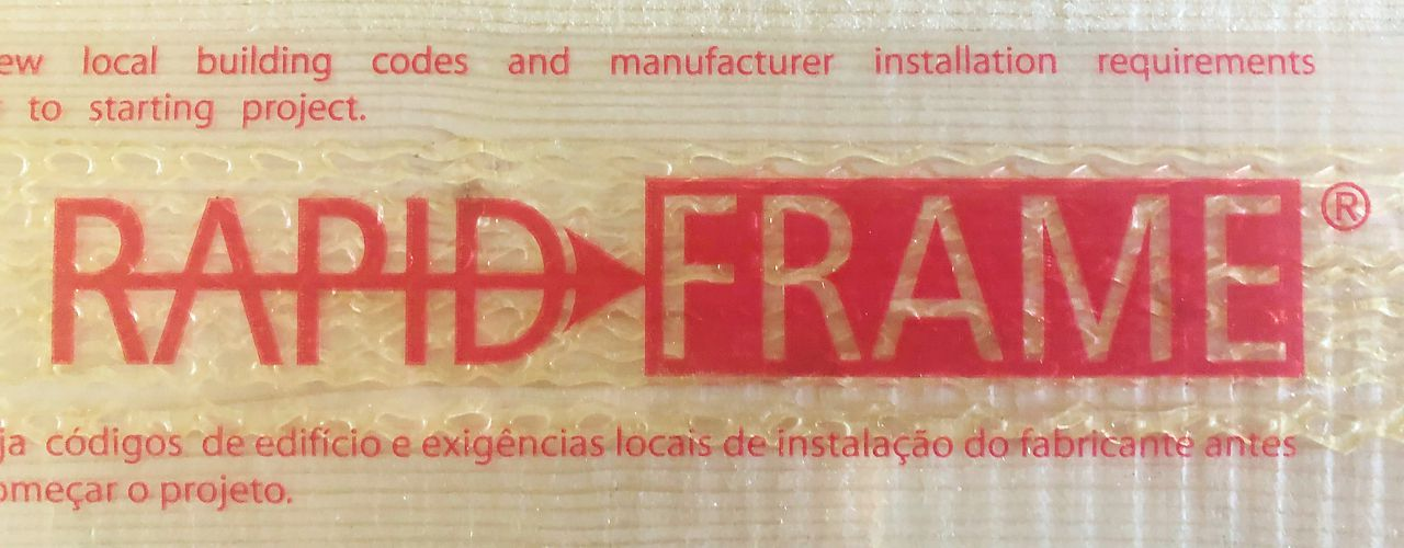 Rapid Frame® logo on protective tape over pre-applied adhesive