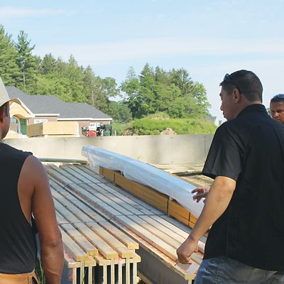 National Lumber representative showing Rapid Frame® products to workers on jobsite