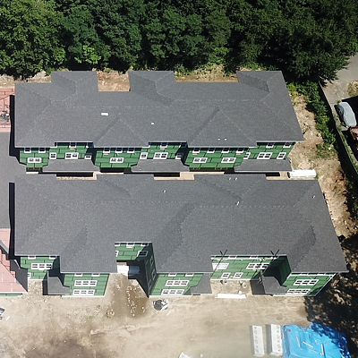 Aerial view overhead showing roof now shingled, and ZipSystem sheathing still visible